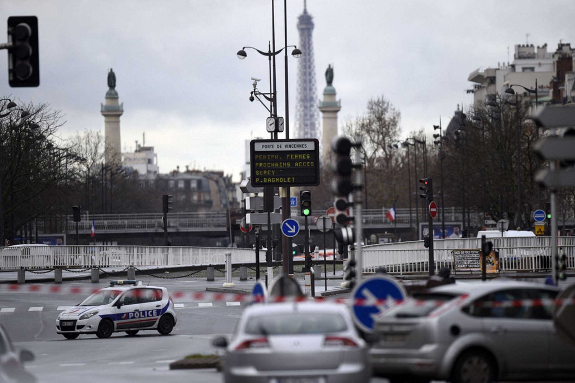 Charlie Hebdo shootings  Hostages held in a kosher grocery store in     Police forces gather together at Porte de Vincennes  east of Paris  after  at least