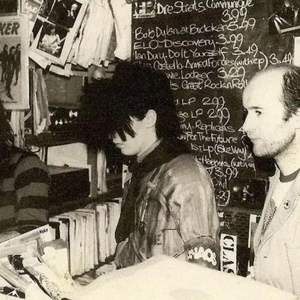 Pete Burns as a Shop Assistant