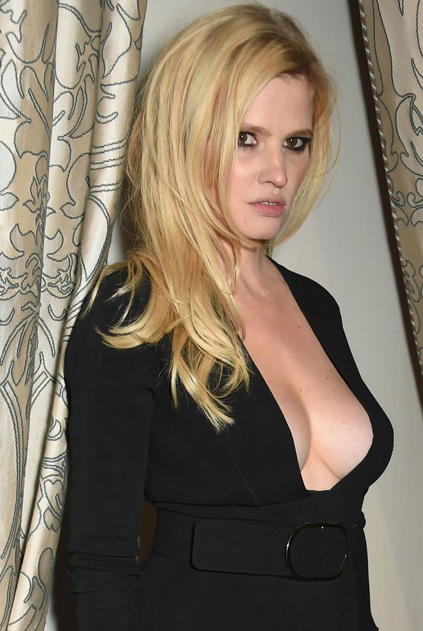 Lara Stone Spills Out Of Plunging Black Dress At Swanky