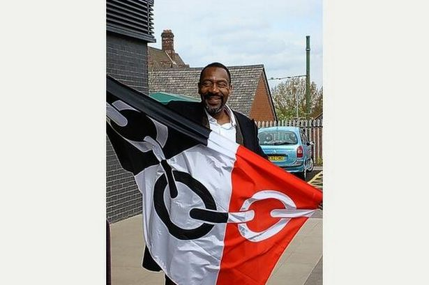 Dudley boy Lenny Henry wielding the Black Country Flag. (c) Birmingham Mail 2014