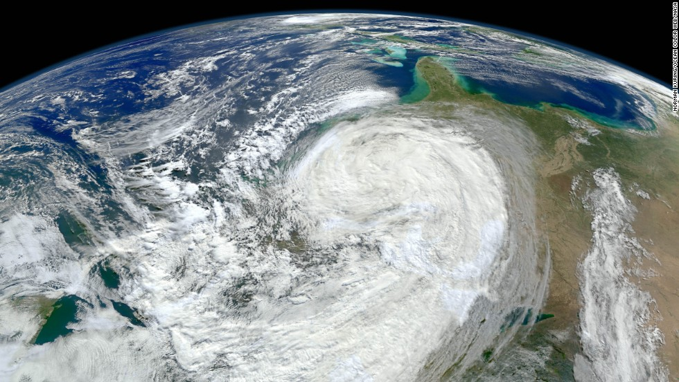 "The planet could see as many as 20 more hurricanes and tropical storms each year by the end of the century because of climate change, according to <a href=""http://www.pnas.org/content/110/41/16361.full.pdf+html"" target=""_blank"">a 2013 study</a> published in the Proceedings of the National Academy of Sciences. This image shows Superstorm Sandy bearing down on the New Jersey coast in 2012."