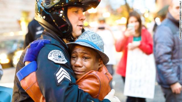 Image result for black boy hugging officer