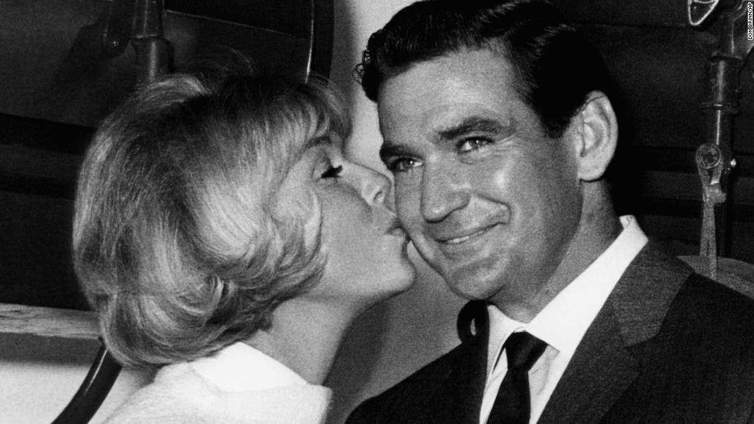 Rod Taylor, Australian movie star, celebrates his 35th birthday by working on the set of ?Do Not Disturb,? and gets a big birthday kiss from co-star Doris Day in Hollywood, Los Angeles, Jan. 14, 1965. It was the opening day of shooting on the movie. Miss Day again has been named to number one sport as movie box office queen in a poll conducted annually by motion picture exhibitors.