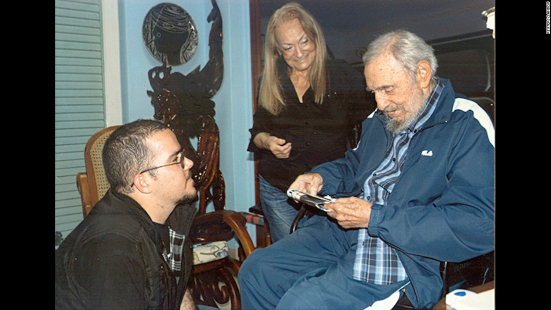 In this picture provided by CubaDebate, Castro talks to Randy Perdomo, president of Cuba's University Students Federation, during a February meeting in Havana.