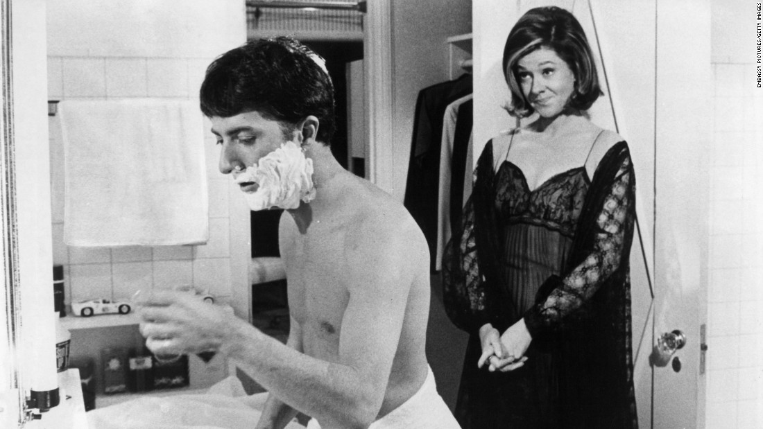 Dustin Hoffman is shaving while Elizabeth Wilson is standing behind him in a scene from the film 'The Graduate', 1967. (Photo by Embassy Pictures/Getty Images)