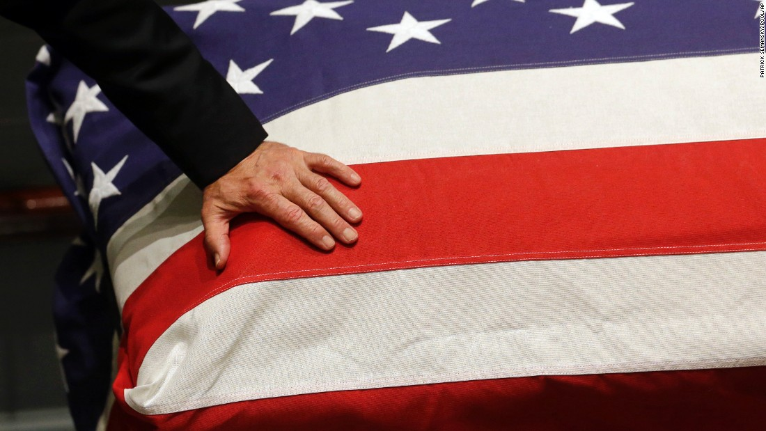 Image result for trump with flag draped casket
