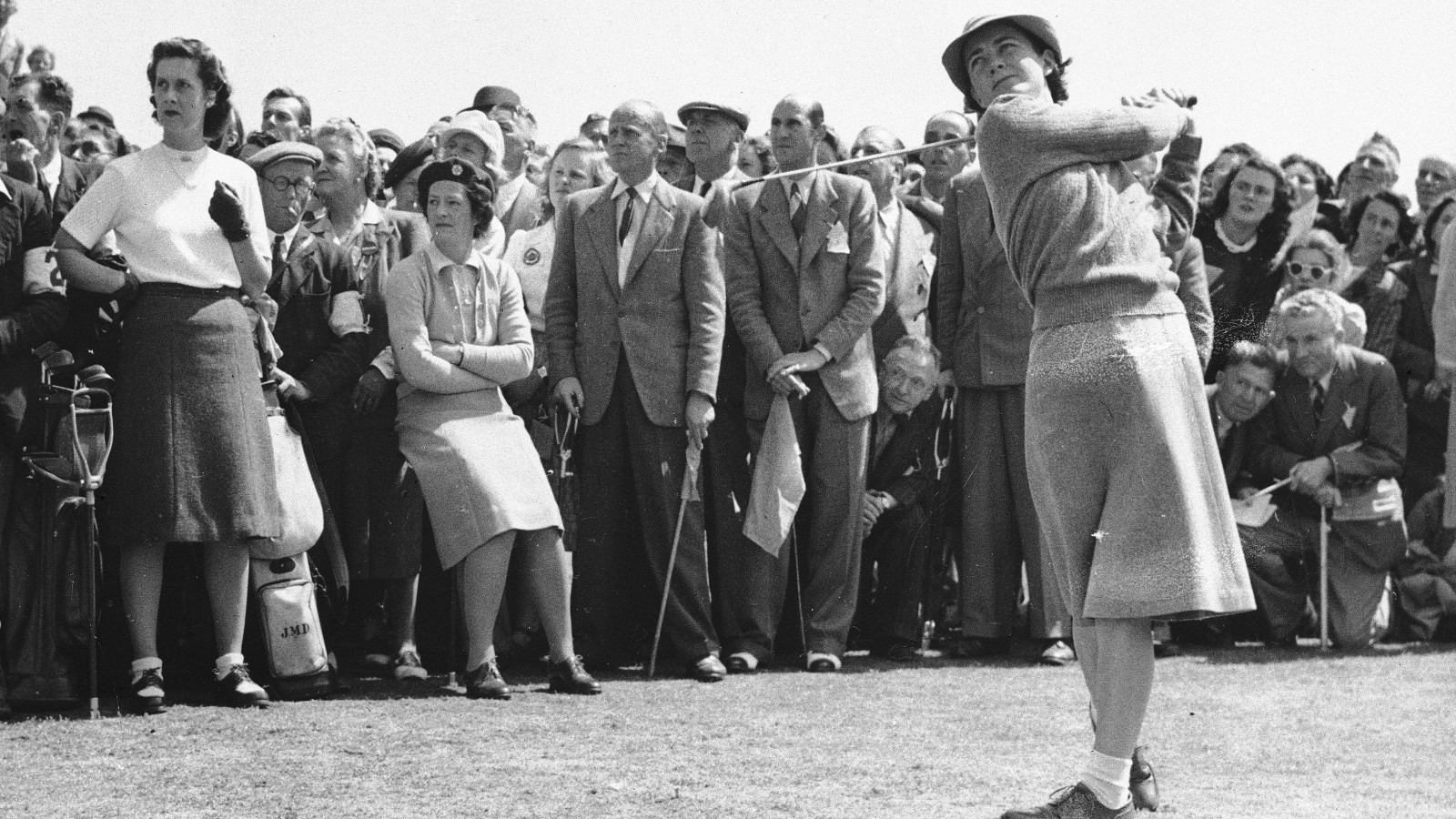 Louise Suggs of Atlanta, Ga., member of the U.S. Curtis Cup Women's golf team, drives at the first tee during the cup matches as Birkdale, England, May 21, 1948.  The U.S. team defeated the British golfers, 6 1/2 to 2 1/2.  (AP Photo)