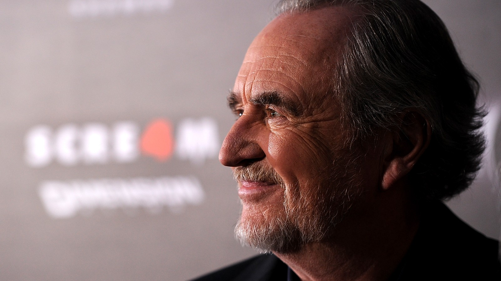 "HOLLYWOOD, CA - APRIL 11:  Director Wes Craven arrives at the premiere of the Weinstein Company's ""Scream 4"" Presented by AXE Shower at Grauman's Chinese Theatre on April 11, 2011 in Hollywood, California."