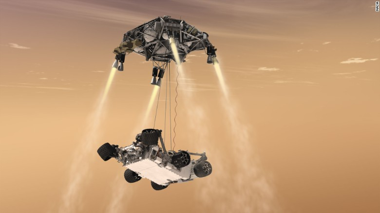 The rover will use the sky crane method for landing, like the Curiosity rover. During the descent, rockets slow it down while the rover is lowered on tethers and an umbilical cord that provides communication and power. Once it has touched down, the rover will cut ties and the rest of the craft will crash land at a safe distance.