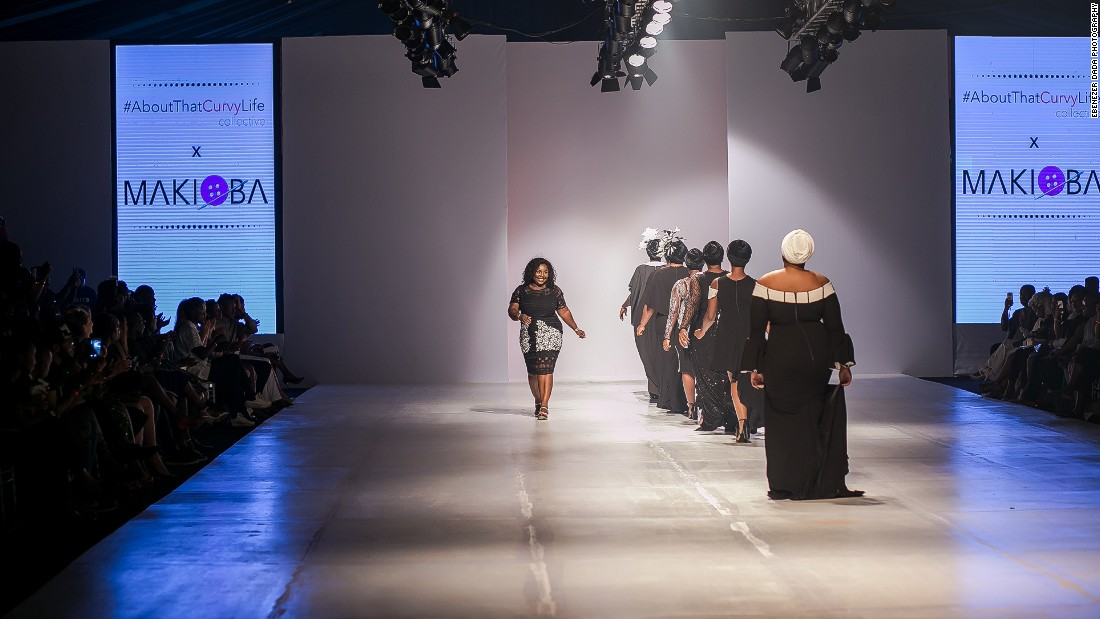 "As the first model took to the runway the crowd brought the house down. Ngwube snuck into the crowd to watch the crowd standing, screaming and clapping. ""I was shaking and crying in the crowd, I couldn't contain it.""<br />Pictured: Designer Makioba Olugbile greets a cheering crowd."