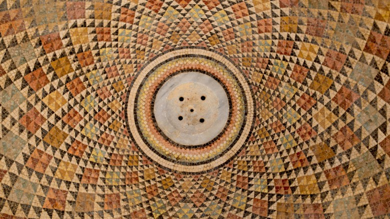 A part of the mosaic at Hisham's Palace features a circular pattern.