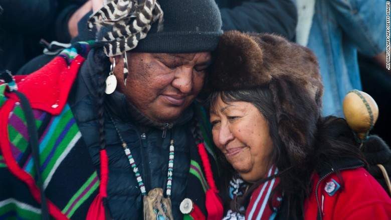 "Activists embrace after the December halt of the <a href=""http://www.cnn.com/2016/09/07/us/dakota-access-pipeline-visual-guide/"" target=""_blank"">Dakota Access Pipeline</a> route. The $3.7 billion project that would cross four states and change the landscape of the US crude oil supply. The Standing Rock Sioux tribe says the pipeline would affect its drinking-water supply and destroy its sacred sites."