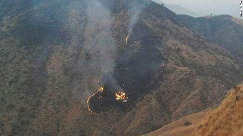 Flames rise from the wreckage of the Pakistan International Airlines flight that crashed Wednesday.