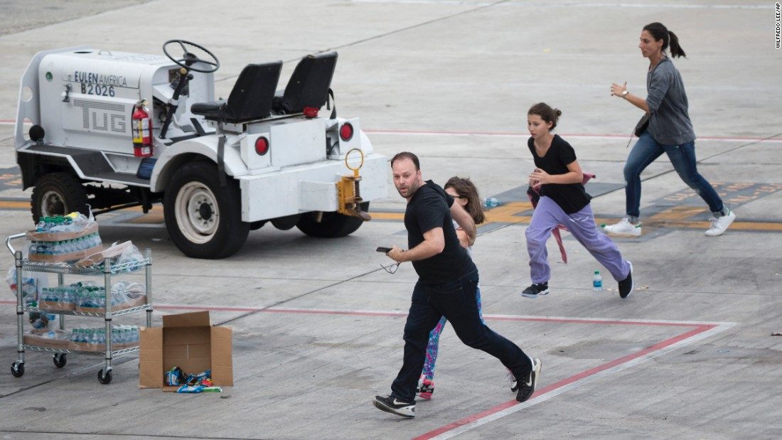 "People run out on the tarmac in the aftermath of the shooting Friday, January 6, at the airport in Fort Lauderdale, Florida. <a href=""http://www.cnn.com/2017/01/06/us/fort-lauderdale-airport-incident/index.html"" target=""_blank"">Five people were killed and eight others were wounded</a>, officials said."