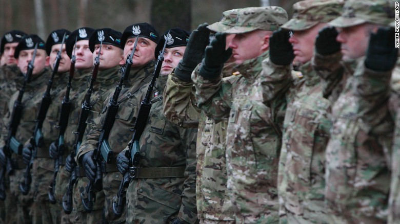 US Army soldiers are welcomed Saturday in Zagan, Poland, as they start a nine-month rotation there.