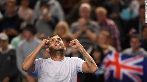 Britain's Daniel Evans celebrates his victory against Australia's Bernard Tomic.