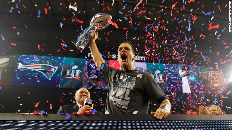 New England quarterback Tom Brady raises the Vince Lombardi Trophy after leading the Patriots to a 34-28 victory in Super Bowl LI on Sunday, February 5. Brady threw for a Super Bowl-record 466 yards as New England completed the biggest comeback in Super Bowl history. The Patriots trailed Atlanta 28-3 in the third quarter but rallied to win in overtime.