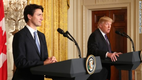 Trump defends travel ban as Trudeau looks on