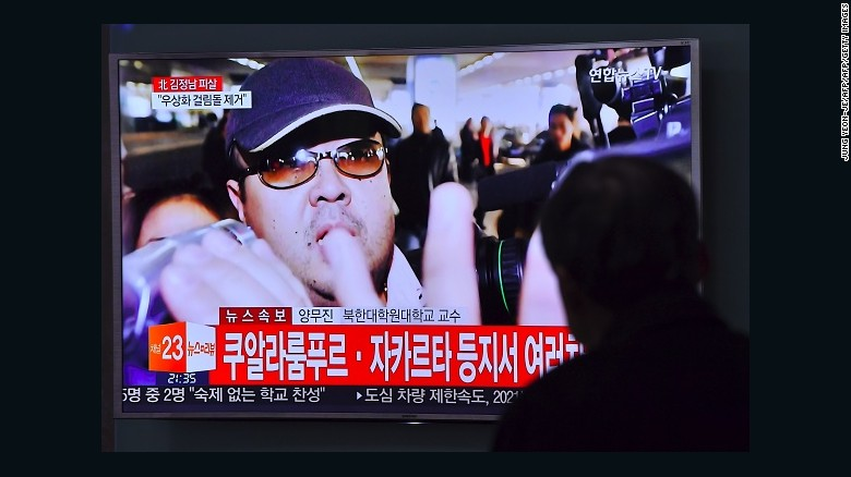 A man watches a television showing news reports of Kim Jong Nam, the half-brother of North Korean leader Kim Jong Un, in Seoul on February 14, 2017.