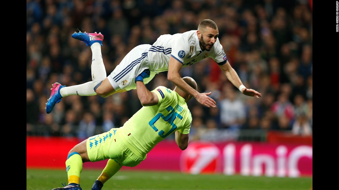 Real Madrid striker Karim Benzema jumps over Napoli goalkeeper Pepe Reina during a Champions League match in Madrid on Wednesday, February 15. Madrid, the tournament's defending champions, won 3-1 in what was the first of a two-legged tie.