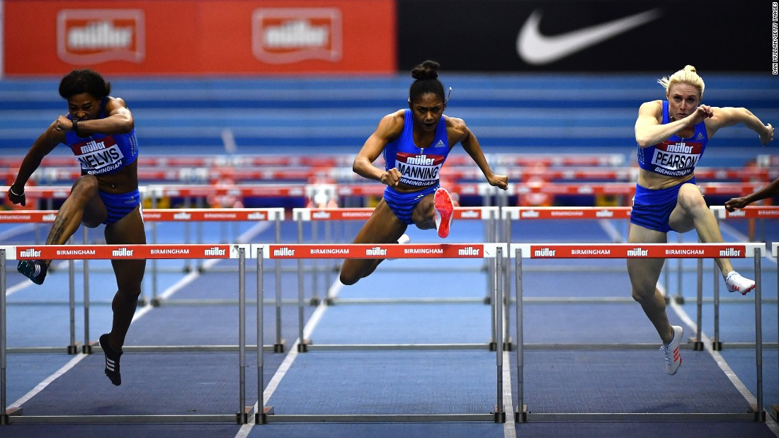 From left, Sharika Nelvis, Christina Manning and Sally Pearson compete in the 60-meter hurdles at an indoor meet in Birmingham, England, on Saturday, February 18. Manning won the event in 7.83 seconds, edging fellow American Nelvis. Pearson, an Australian, finished in third.