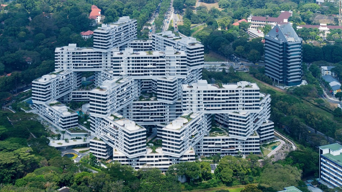 "In his new book ""Building Community: New Apartment Architecture,"" Michael Webb looks at 30 of the world's most compelling new apartment buildings. <br /><br />The Interlace comprises 31 identical six-story blocks stacked on top of each other. In the spaces between them are eight courtyards and an Olympic-sized swimming pool, creating a micro community outside of the city center. <br /><br />""We wanted togetherness, not isolation; a return to when Singapore was a village of little buildings, tightly knit together,"" Ole Scheeren says in the book."