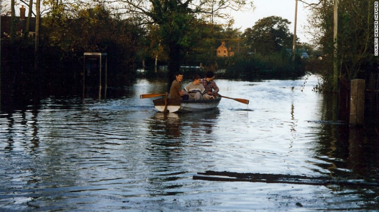 The Shepherd sons used a boat to get around the flooded village.