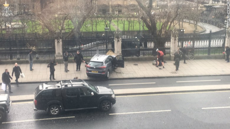 "A car is seen crashed into a fence outside the Parliament building in London on Wednesday, March 22. Police have <a href=""http://www.cnn.com/2017/03/22/europe/uk-parliament-firearms-incident/index.html"" target=""_blank"">launched a ""full counter-terrorism investigation""</a> after an attacker rammed a car into crowds of people and stabbed a police officer on Parliament grounds."