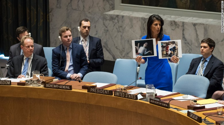UN Ambassador Nikki Haley holds up photos of victims of the Syrian chemical attack during a Security Council meeting.