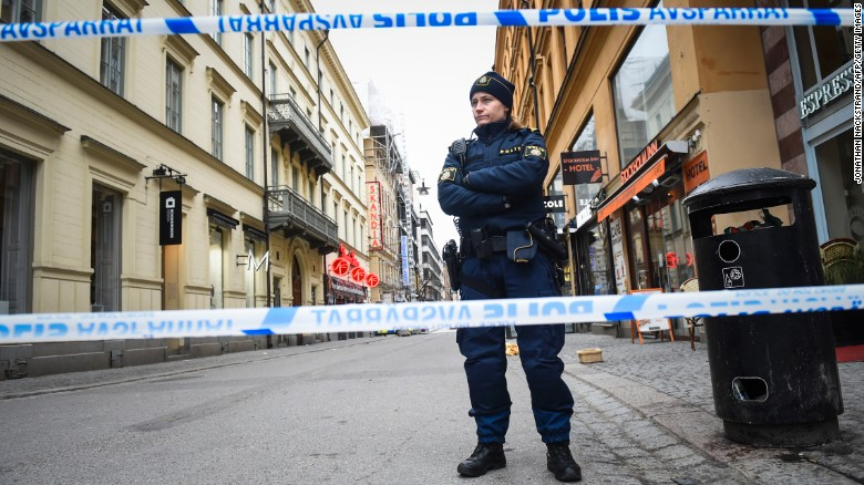 A police officer stands guard at the attack site.