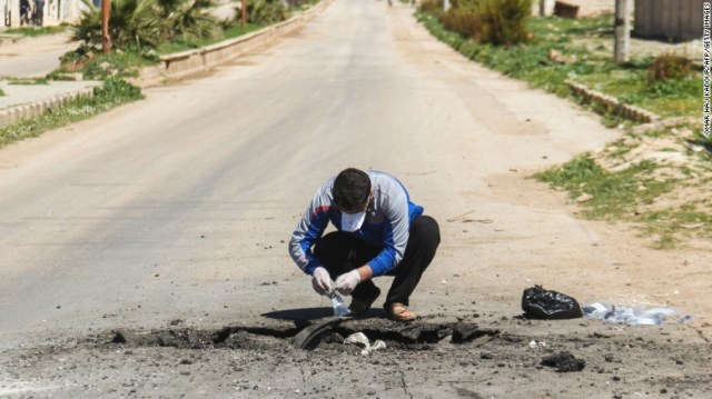 Samples are taken from the site of a suspected chemical attack in Khan Sheikhoun.