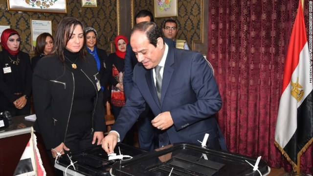 President of Egypt Abdel Fattah el-Sisi casts his vote during parliamentary elections in Cairo on November 22, 2015.