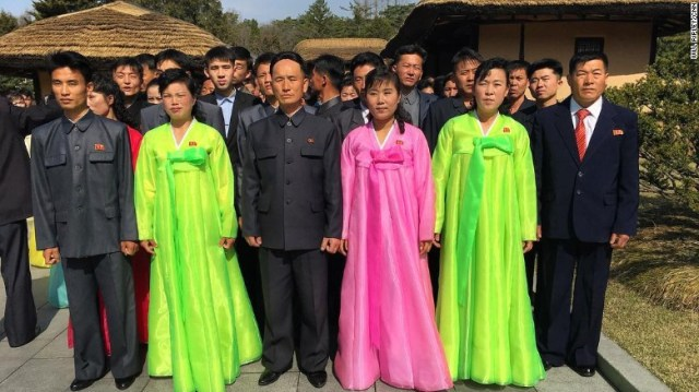 North Koreans pose for a photograph at Mangyongdae, which is the birthplace of their late founder Kim Il Sung.