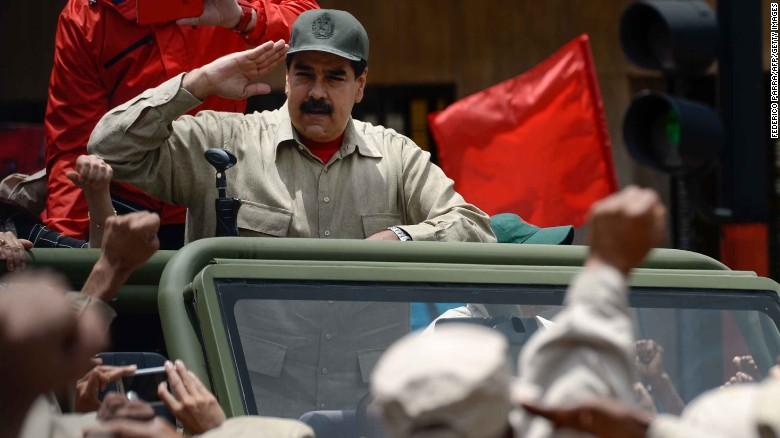 Venezuelan President Nicolas Maduro salutes Monday during Bolivarian militia celebrations in Caracas.