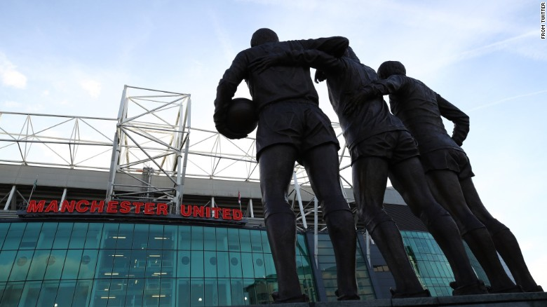 """Manchester United tweeted its condolences accompanied by a photo of the iconic """"Holy Trinity"""" statue in front of Old Trafford."""