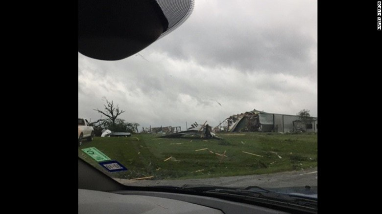 """Hayley Herron, 17, lives in Canton, Texas. She and her family went out to see the damage between the second and third storms. """"The damages were horrible,"""" she said."""