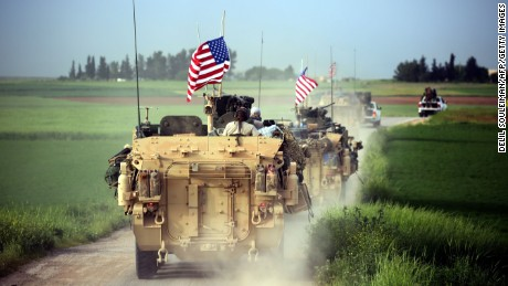 US forces accompanied by the Kurdish People's Protection Units (YPG) near the Syrian border with Turkey in April.