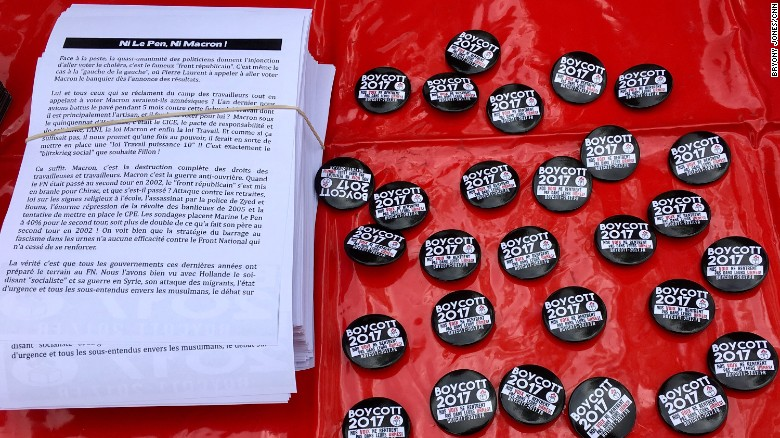 """Boycott 2017 badges at a May Day rally in Paris. The Boycott 2017 campaign calls on voters to back """"neither Le Pen, nor Macron."""