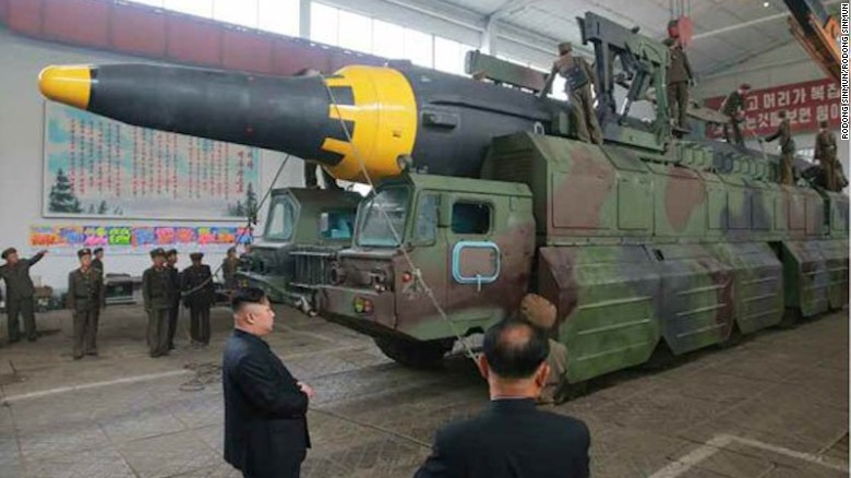 An image from North Korean state media shows leader Kim Jong with a missile on a mobile launcher.