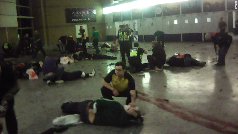 People tend to the injured inside the Manchester Arena after the attack Monday night.