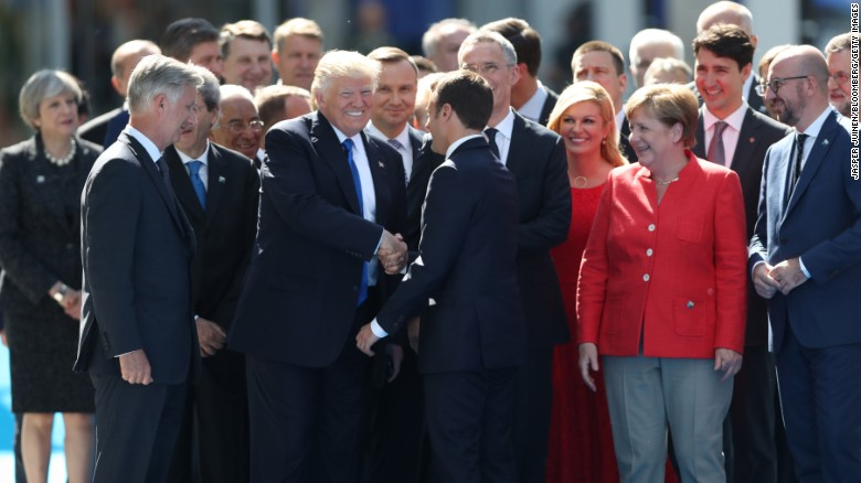 "US President Donald Trump shakes hands with Emmanuel Macron, France's new president, as other world leaders look on in Brussels, Belgium, on Thursday, May 25. They were attending <a href=""http://www.cnn.com/2017/05/25/politics/trump-nato-financial-payments/"" target=""_blank"">a NATO summit</a> as the alliance officially opened a new $1 billion headquarters."