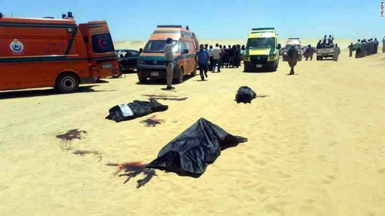 Bodies lie in the desert after the bus attack on Coptic Christians near Minya in Egypt on Thursday.