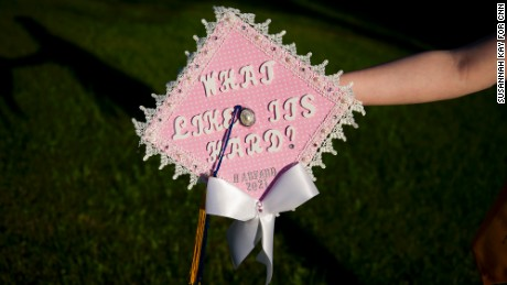 Grace Bannister shows off her graduation cap in her backyard in Chapmanville, West Virginia. Bannister graduated this year as valedictorian of her class and plans to attend Harvard University in the fall.