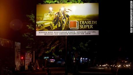 A board advertises a cigarette brand along a road in Yogyakarta, Indonesia, in 2011.