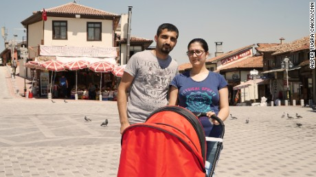 Volkan Guner with his partner Merve, also 27, and their three-month child.