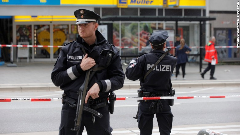 Police cordon off the area around the Hamburg supermarket where the attack occurred Friday.