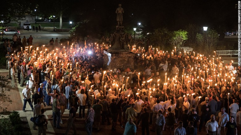 White nationalists carrying torches surround protesters Friday night at the foot of a statue of Thomas Jefferson on the University of Virginia's campus.