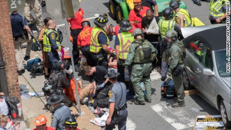 People Receive First Aid After A Car Accident Ran Into A Crowd Of Protesters In