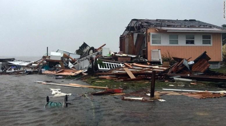 A damaged home sits amid a flood on Saturday after Hurricane Harvey slammed Rockport, Texas.