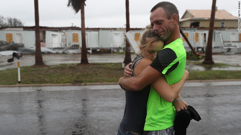 Jessica Campbell hugs Jonathan Fitzgerald after riding out Hurricane Harvey in an apartment on August 26, 2017 in Rockport.
